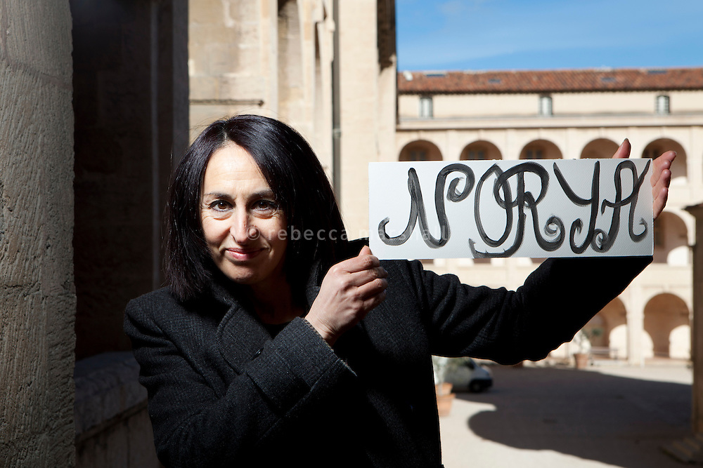 Norya, a volunteer guide with the Marseille Provence Greeters, poses for the photographer at La Vieille Charité, a former almshouse and now museum and cultural centre, Marseille, France, 04 February 2013