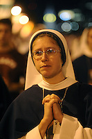A Sister of Life from New York, New York pray while listening to Pope Francis speak on the Ben Franklin Parkway during the Festival of Families Saturday September 26, 2015 in Philadelphia, Pennsylvania. Pope Francis is expected to speak at the festival. (Photo By William Thomas Cain)