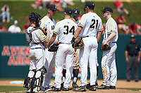 Army Black Knights pitching coach Jamie Pinzino holds a meeting on the mound during the game against the North Carolina State Wolfpack at Doak Field at Dail Park on June 3, 2018 in Raleigh, North Carolina. The Wolfpack defeated the Black Knights 11-1. (Brian Westerholt/Four Seam Images)