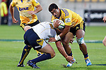 Hurricanes' second five-eighth Cardiff Vaega, right, runs into ACT Brumbies' prop Ben Alexander, left, in the Super Rugby match at Westpac Stadium, Wellington, New Zealand, Friday, March 07, 2014. Credit: Dean Pemberton
