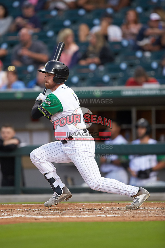 Charlie Tilson (1) of the Caballeros de Charlotte follows through on his swing against the Buffalo Bisons at BB&T BallPark on July 23, 2019 in Charlotte, North Carolina. The Bisons defeated the Caballeros 8-1. (Brian Westerholt/Four Seam Images)