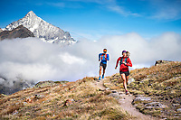 Trail running above Zermatt, Switzerland with views of the 4000 meter Weisshorn.