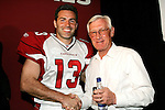 The Arizona Cardinals today unveiled their new uniforms for the 2005/2006 season.  Here quarterback Kurt Warner and Cardinals legend Larry Wilson meet on the side of the runway.