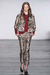 """Model Laura walks runway in a wool crew neck sweater in boysenberry, Ikat landscape motif jacquard jacket with matching trouser, from the Vivienne Tam Fall Winter 2016 """"Cultural Dreamland The New Silk Road"""" collection, presented at NYFW: The Shows Fall 2016, during New York Fashion Week Fall 2016."""