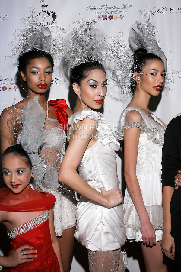 Models pose on the red carpet, after her Sushma Patel Spring 2011 show, during Couture Fashion Week.