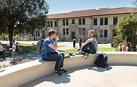 Jack Kearney '20 (left) and Johnny Hammer '21 talk at the JSC fountain overlooking the Academic Quad, March 28, 2018.<br /> (Photo by Marc Campos, Occidental College Photographer)