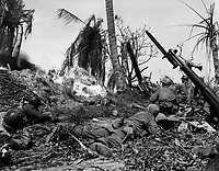 Men of the 7th Div. using flame throwers to smoke out Japs from a block house on Kwajalein Island, while others wait with rifles ready in case Japs come out. February 4, 1944.  Cordray. (Army)<br /> NARA FILE #:  iii-SC-212770<br /> WAR &amp; CONFLICT BOOK #:  1187