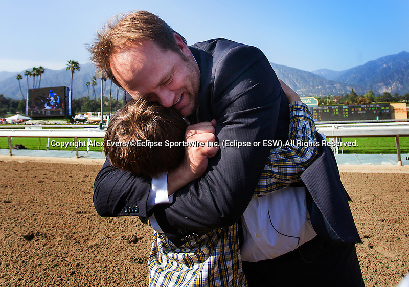 Arcadia CA- April 06:  Trainer Doug O'Neil hugs his son after winning the 2013 running of the Santa Anita Derby with Goldencents in Arcadia, CA on April 6, 2013. (Alex Evers/ Eclipse Sportswire)