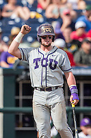 TCU Horned Frogs catcher Evan Skoug (9) celebrates scoring against the LSU Tigers in the NCAA College World Series on June 14, 2015 at TD Ameritrade Park in Omaha, Nebraska. TCU defeated LSU 10-3. (Andrew Woolley/Four Seam Images)