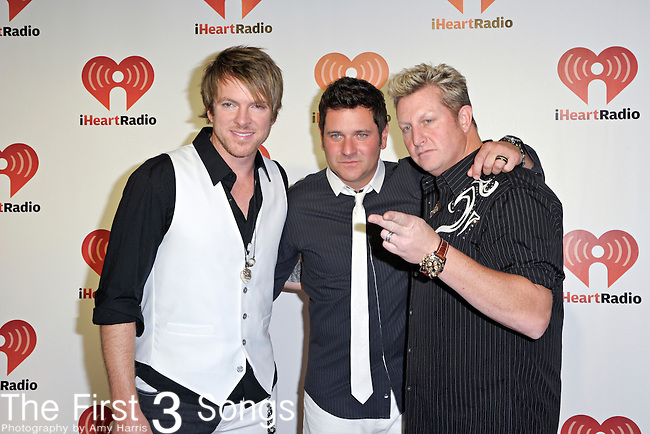Joe Don Rooney, Jay DeMarcus, and Gary LeVox of Rascal Flatts attend the 2011 iHeartRadio Music Festival on September 24, 2011 at the MGM Grand Garden Arena in Las Vegas, Nevada.