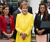 Former United States Senator Elizabeth Dole (Republican of North Carolina), center, attends the signing ceremony of S. 2372 – VA Mission Act of 2018 at the White House in Washington, DC, June 6, 2018. Credit: Chris Kleponis / CNP