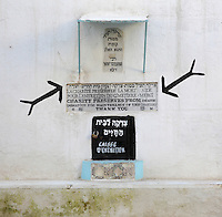 Donation box with sign in Hebrew, French and English at the entrance to the Jewish cemetery in the South West corner of the Mellah or Jewish quarter, established in 1438 when the Jews were driven out of the old town to al-Mallah, Fes, Fes-Boulemane, Northern Morocco. The oldest tombs date to the 16th century. In the 9th century, Idriss II admitted many Jews to Fes from Andalusia, the Jewish community thrived here until the 11th century. Picture by Manuel Cohen