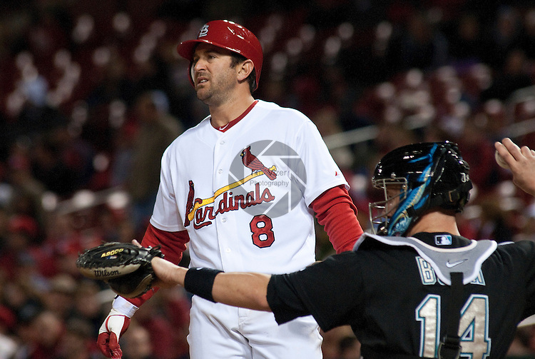 03 May 2011                             St. Louis Cardinals third baseman Nick Punto (8) late in the game, as Florida Marlins catcher John Buck (14) returns the ball to the pitcher.  The St. Louis Cardinals defeated the Florida Marlins 7-5 on Tuesday May 3, 2011 in the second game of a four-game series at Busch Stadium in downtown St. Louis.