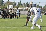 Palos Verdes CA 10/22/10 - Okuoma Idah (Peninsula #24) and Devin Christy (Leuzinger #5) in action during the Leuzinger - Peninsula varsity football game at Palos Verdes Peninsula High School.
