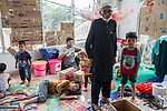 28 August 2019, Jakarta, Indonesia: - 73 year old Mohammad Hanif with his and other Afghan families inside their shared room at the UNHCR refugee centre in Kalideres, Jakarta. Plans to re-locate the overcrowded refugees have been fast tracked after a fight broke out between the groups, many of whom have been in Indonesia for years waiting for placement. Tensions ran high between Afghan and African groups in the centre with a lack of adequate food for the refugees being the catalyst. The African groups, who were moved onto the footpath, were being bussed out today. Conditions in the centre are grim and the local Indonesian population not happy with the refugees presence in the suburb.Picture by Graham Crouch/The Australian