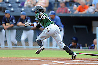 Augusta GreenJackets center fielder Jesus Galindo #33 runs to first during a game against the Asheville Tourists at McCormick Field on June 27, 2013 in Asheville, North Carolina. The Tourists won the game 10-6. (Tony Farlow/Four Seam Images)