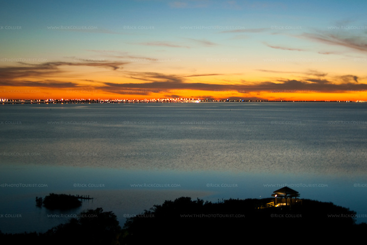 A golden sunset illuminates Tampa Bay.  Tampa, Florida, USA.