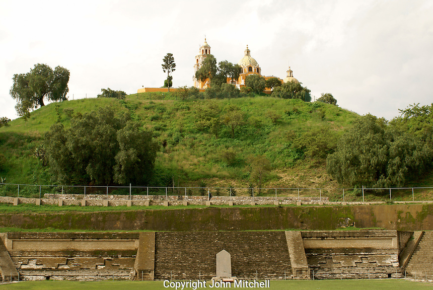Pre-Hispanic ruins at base of Tapaneca Pyramid and Santuario de Nuestra Senora de los Remedios church in Cholula, Puebla, Mexico. Cholula is a UNESCO World Heritage Site.