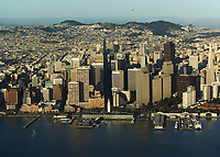 aerial photograph Embarcadero waterfront San Francisco from the bay with Embarcadero Center and ferry building in the foreground