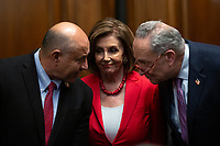 Speaker of the United States House of Representatives Nancy Pelosi (Democrat of California) and United States Senate Minority Leader Chuck Schumer (Democrat of New York) speak to each other during a press conference on the Deferred Action for Childhood Arrivals program on Capitol Hill in Washington D.C., U.S. on Tuesday, November 12, 2019.  The Supreme Court is currently hearing a case that will determine the legality and future of the DACA program.  <br /> <br /> Credit: Stefani Reynolds / CNP /MediaPunch