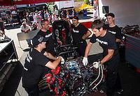 Jun. 1, 2014; Englishtown, NJ, USA; Crew members for NHRA funny car driver Cruz Pedregon during the Summernationals at Raceway Park. Mandatory Credit: Mark J. Rebilas-