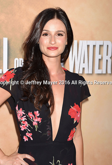 HOLLYWOOD, CA - AUGUST 10: Actress Melanie Papalia arrives at the screening of CBS Films' 'Hell Or High Water' at ArcLight Hollywood on August 10, 2016 in Hollywood, California.