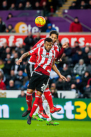 Ryan Bertrand of Southampton  jumps in the air during the Barclays Premier League match between Swansea City and Southampton  played at the Liberty Stadium, Swansea  on February 13th 2016