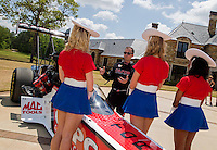 Apr 22, 2014; Kilgore, TX, USA; NHRA top fuel dragster driver Steve Torrence (center) explains the procedures of racing with the Kilgore College Rangerettes at the Torrence estate. Mandatory Credit: Mark J. Rebilas-USA TODAY Sports