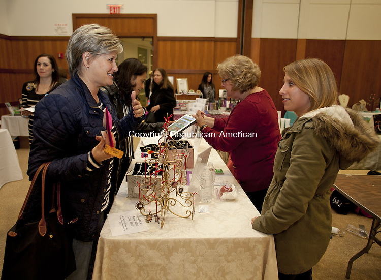 SOUTHBURY, CT-14 November 2013-111413BF09- Dawn Damiani, left, from Southbury talks with Emily Misiewicz also of Southbury while she shops during the 8th Annual Mom's Night Out event at the Walzer Family Jewish Community Campus in Southbury Thursday night. Emily was helping her mother Judy, in red, talking with Marjorie Penzetta, operate her mother's Twin Heart Designs jewelry booth. The event is held as a fundraiser for the Alef Bet Preschool, an early childhood education program of the Federation of Jewish Communities of Western Connecticut.  Bob Falcetti Republican-American