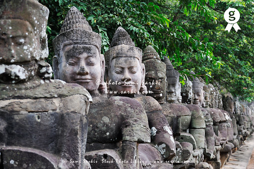 Carved stone statues aligned at South Gate to Angkor Thom, Angkor Wat, Siem Reap, Cambodia<br /> (Licence this image exclusively with Getty: http://www.gettyimages.com/detail/85071208 )