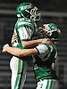 Seaford No. 23 Danny Roell, left, gets congratulated by No. 32 Frank Lauretti after he raced into the endzone in the second quarter of a Nassau County varsity football Conference IV semifinal against Clarke at Hofstra University on Thursday, Nov. 12, 2015. Roell ran for 204 yards and four touchdowns in the first half. Seaford went to halftime leading 42-0.<br /> <br /> James Escher