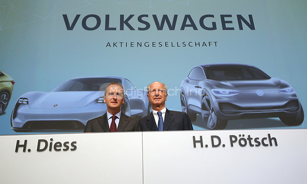 dpatop - 03 May 2018, Germany, Berlin: Herbert Diess (L), CEO of Volkswagen AG, and Hans Dieter Poetsch, chairman of the supervisory board at Volkswagen AG, pictured at the Volkswagen AG annual general meeting at the Messegelaende in Berlin. Photo: Wolfgang Kumm/dpa /MediaPunch ***FOR USA ONLY***
