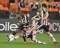 Sainey Nyassi (27) of D.C. United goes against Omar Esparza (9) of C.D. Guadalajara. C.D.Guadalajara tied D.C. United 1-1 during and international friendly, at RFK Stadium, Friday July 12, 2013.