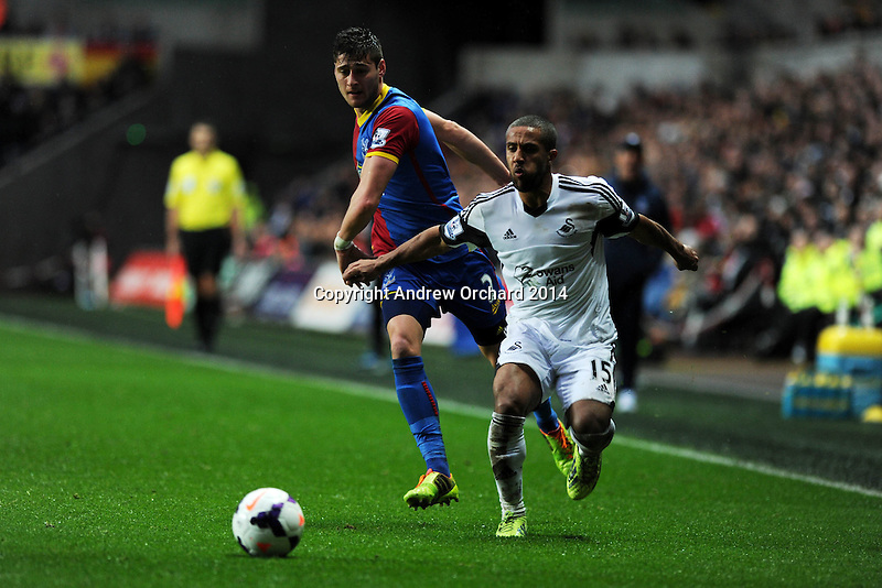 Swansea city's Wayne Routledge makes a break.  Barclays Premier league, Swansea city v Crystal Palace match at the Liberty Stadium in Swansea, South Wales on Sunday 2nd March 2014.