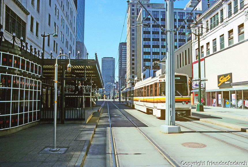 Buffalo: Metro Rail, Early 1980's. Main St., for a mile out from downtown, new rail.