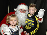 Cian and Teagan Shannon pictured with Santa at the Castle Manor childrens Christmas party in the Rugby Club. Photo:Colin Bell/pressphotos.ie