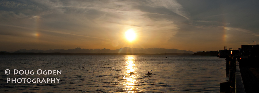 Pano of kayakers on Elliot Bay during a Sun Dog sunset.