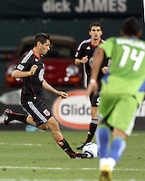 Branko Boskovic #27 of D.C. United sends the ball past Tyrone Marshall #14 of Seattle Sounders FC during an MLS match at RFK Stadium on July 15 2010, in Washington DC.Seattle won 1-0.