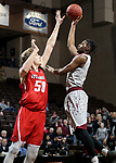 SIOUX FALLS, SD - MARCH 12:  Aaron Thomas 13 from IU East shoots over the defense of Evan Maxwell #50 from Indiana Wesleyan during their semifinal game at the 2018 NAIA DII Men's Basketball Championship at the Sanford Pentagon in Sioux Falls. (Photo by Dave Eggen/Inertia)
