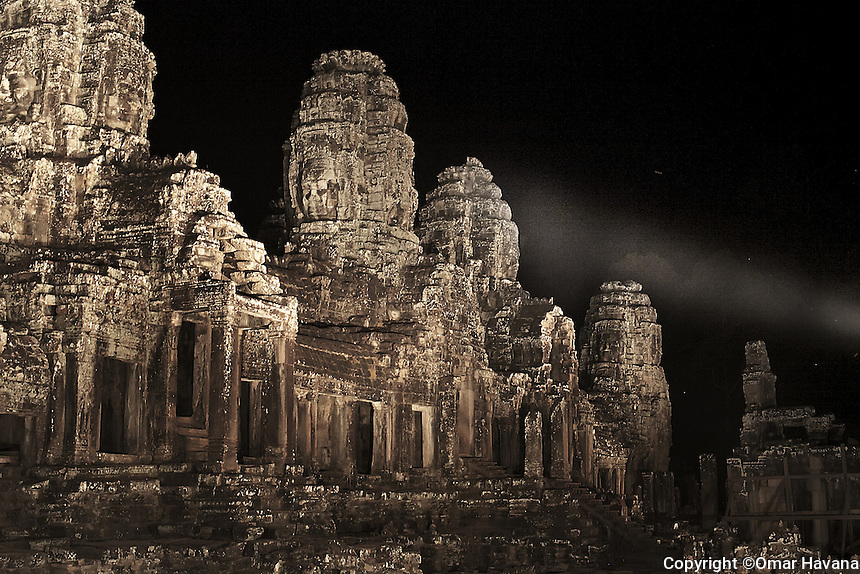 ANGKOR TEMPLES, CAMBODIA. Bayon temple is illuminated during the night for one of the private dinners available for guests. Hotels and travel agencies in Siem Reap organize private and exclusive dinners in few of the temples of Angkor. Photo: ©Omar Havana