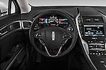 Steering wheel view of a 2013 Lincoln MKZ Hybrid Sedan