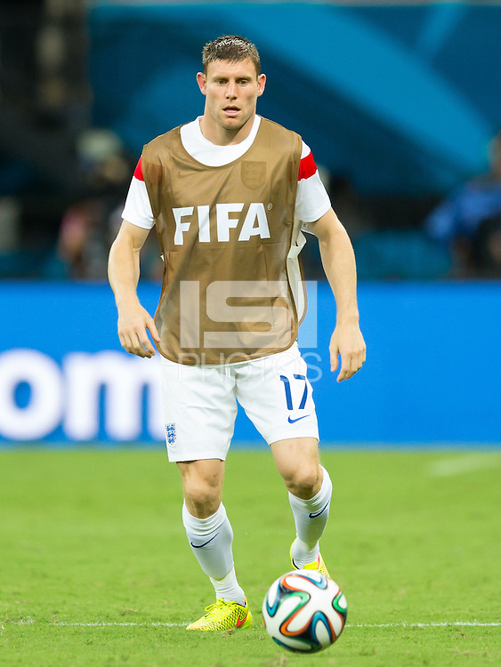 James Milner of England warming up at half time