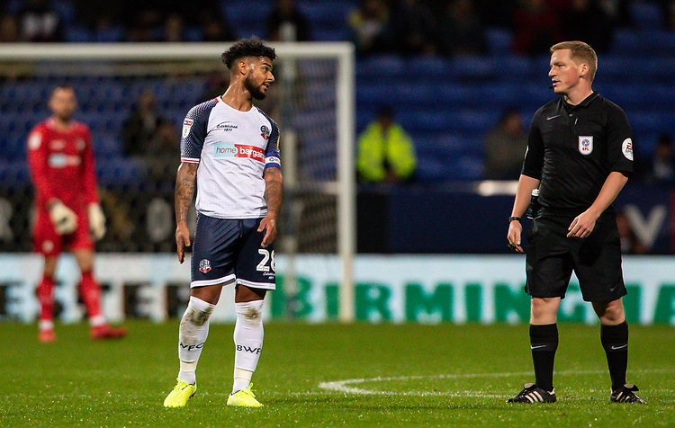 Bolton Wanderers' Liam Bridcutt converses with referee John Busby <br /> <br /> Photographer Andrew Kearns/CameraSport<br /> <br /> The EFL Sky Bet League One - Bolton Wanderers v Blackpool - Monday 7th October 2019 - University of Bolton Stadium - Bolton<br /> <br /> World Copyright © 2019 CameraSport. All rights reserved. 43 Linden Ave. Countesthorpe. Leicester. England. LE8 5PG - Tel: +44 (0) 116 277 4147 - admin@camerasport.com - www.camerasport.com