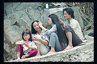 Vietnamese refugee women help each other to clean their hair at a boat people camp on an outlying island in Hong Kong. Tens of thousands of Vietnamese refugees fled the Communist regime by boats to Hong Kong in 1980s.