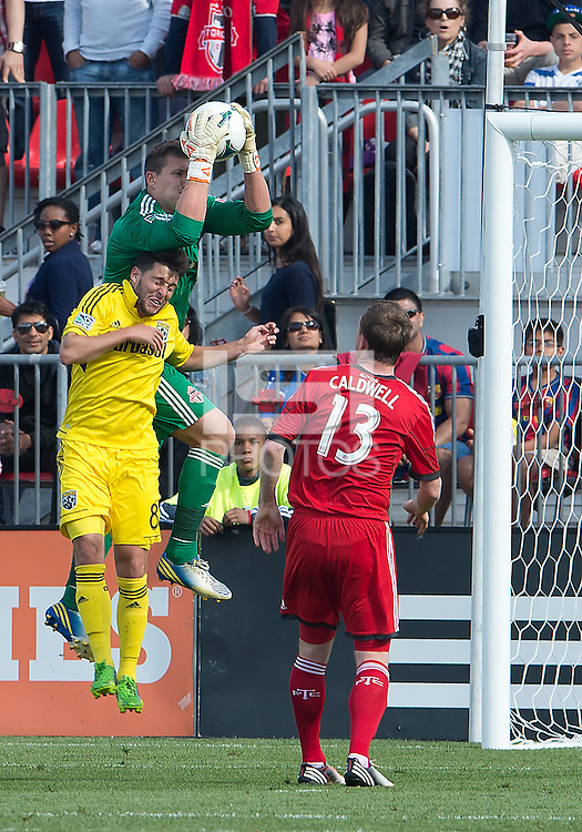 18 May 2013: Toronto FC goalkeeper Joe Bendik #12 and Columbus Crew midfielder Matias Sanchez #8 in action during an MLS game between the Columbus Crew and Toronto FC at BMO Field in Toronto, Ontario Canada..The Columbus Crew won 1-0...