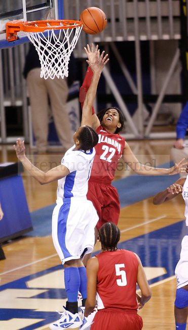 UK guard A'dia Mathies attempts to block Khristin Lee of Alabama's shot during the first half of the UK Women's basketball game against Alabama on 1/29/12 at Memorial Coliseum in Lexington, Ky. Photo by Quianna Lige | Staff