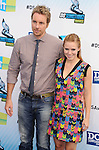 SANTA MONICA, CA - AUGUST 19: Dax Shepard and Kristen Bell  arrive at the 2012 Do Something Awards at Barker Hangar on August 19, 2012 in Santa Monica, California.