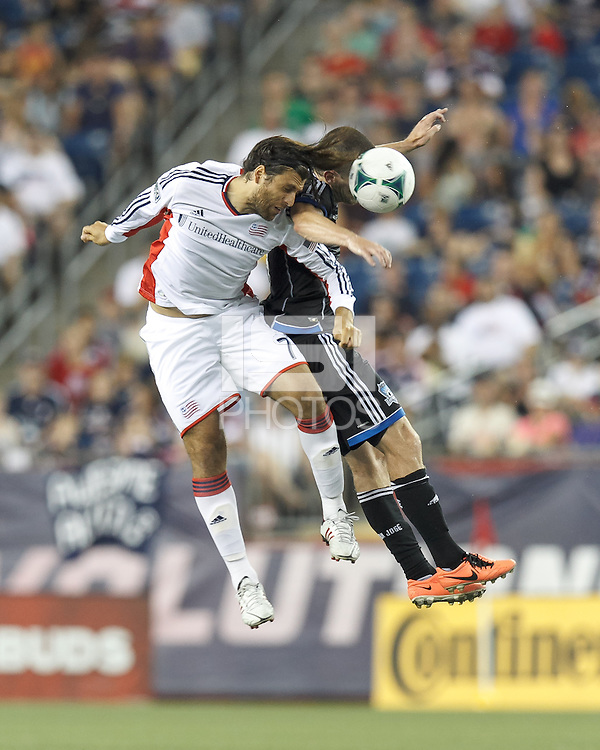 New England Revolution substitute midfielder Juan Carlos Toja (7) and San Jose Earthquakes midfielder Sam Cronin (4) battle for head ball.  In a Major League Soccer (MLS) match, the New England Revolution (white) defeated San Jose Earthquakes (black), 2-0, at Gillette Stadium on July 6, 2013.
