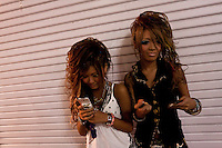 Young women wearing Gyaru kei fashions in Center Gai, Shibuya, Tokyo, Japan. Friday July 1st 2011