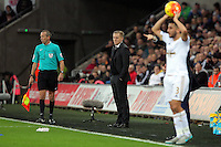 Swansea manager Garry Monk (C) stand impassive on the touchline after conceding a second goal during the Barclays Premier League match between Swansea City and Leicester City at the Liberty Stadium, Swansea on December 05 2015